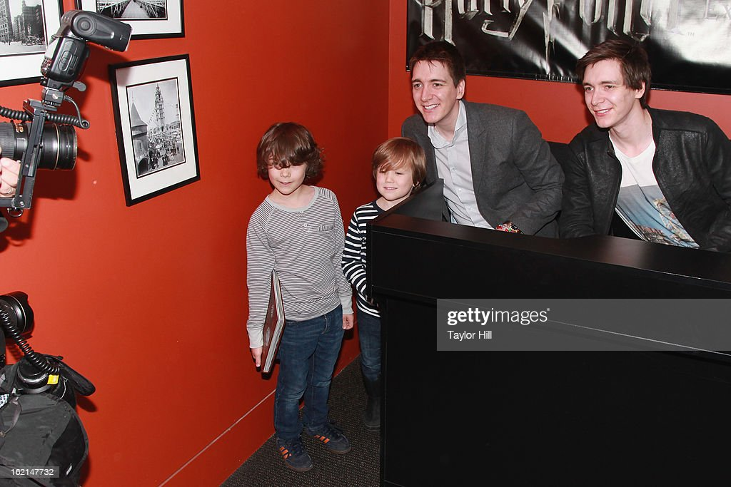 Twin actors <a gi-track='captionPersonalityLinkClicked' href=/galleries/search?phrase=Oliver+Phelps&family=editorial&specificpeople=810288 ng-click='$event.stopPropagation()'>Oliver Phelps</a> and Jamie Phelps pose with fans at Discovery Times Square on February 19, 2013 in New York City.