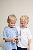 Twin boys sharing mp3 player