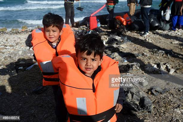 Twin boys wait along with other migrants and refugees to board a dinghy to travel to the Greek island of Chios from Cesme in the Turkish province of...