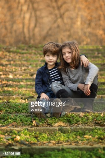 Twin Brother And Sister Hugging In Forest Stock Photo ...