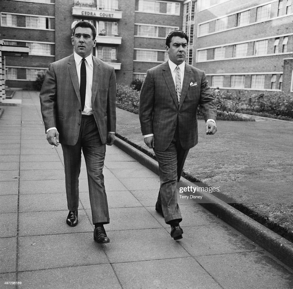 Twin brothers and organised crime bosses Ronnie and <a gi-track='captionPersonalityLinkClicked' href=/galleries/search?phrase=Reggie+Kray&family=editorial&specificpeople=240485 ng-click='$event.stopPropagation()'>Reggie Kray</a> in Cedra Court, off Cazenove Road in northeast London, 3rd August 1964.