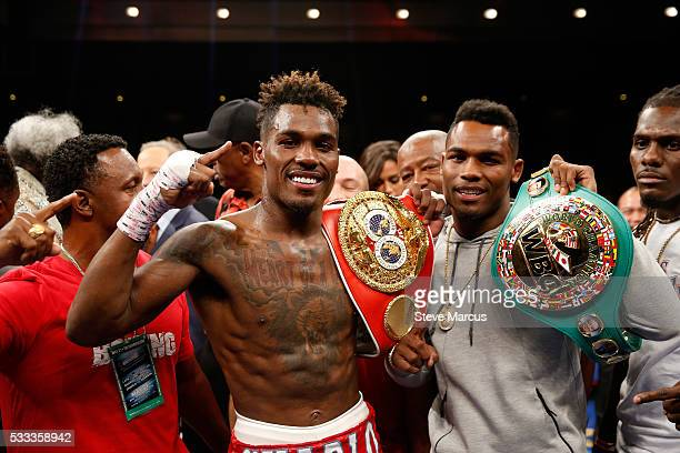 Twin brothers IBF junior middleweight champion Jermall Charlo and WBC super welterweight champion Jermell Charlo pose with their titles at The...