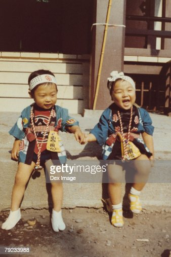 Twin brothers in Japanese costume : Stock Photo