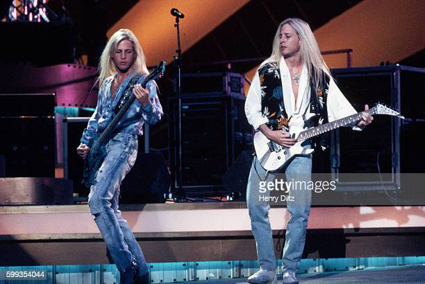 Twin brothers Mathew and Gunnar Nelson of the band Nelson play guitar during a 1991 television filming of the Billboard Awards