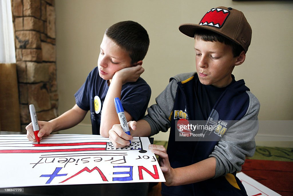 Twin brothers Nathan Gray (L) 10, and Kyle Gray, 10, both of Mead, Colorado work on a sign in support of Republican presidential candidate, former Speaker of the House Newt Gingrich before a campaign rally at the Marriott Denver West February 6, 2012 in Golden, Colorado. Gingrich is visiting Colorado to meet supporters and share his solutions for creating jobs, balancing the budget and paying down our national debt in advance of Tuesday's Republican Caucuses in the state.