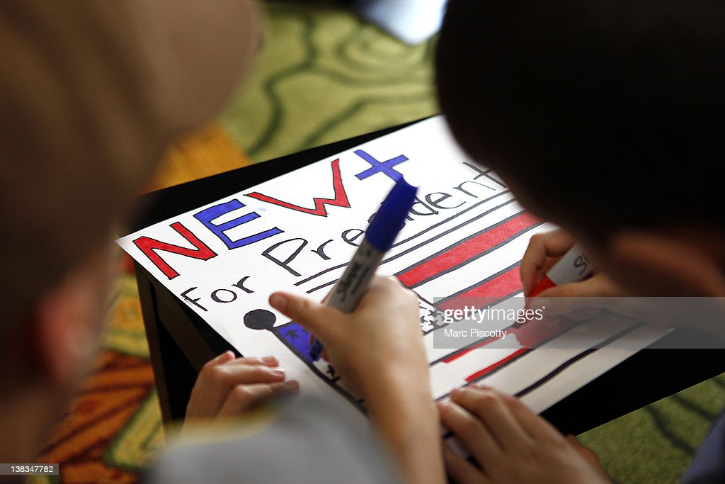 Twin brothers Nathan Gray (right), 10, and Kyle Gray (left), 10, both of Mead, Colorado work on a sign in support of Republican presidential candidate, former Speaker of the House Newt Gingrich before a campaign rally at the Marriott Denver West February 6, 2012 in Golden, Colorado. Gingrich is visiting Colorado to meet supporters and share his solutions for creating jobs, balancing the budget and paying down our national debt in advance of Tuesday's Republican Caucuses in the state.