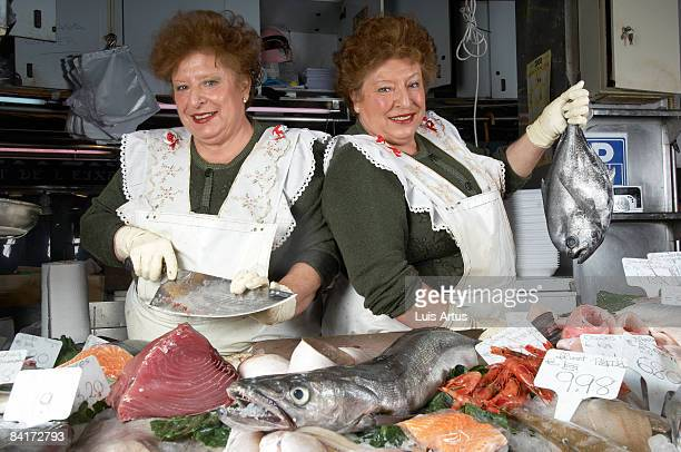 Twin fishmongers at stall