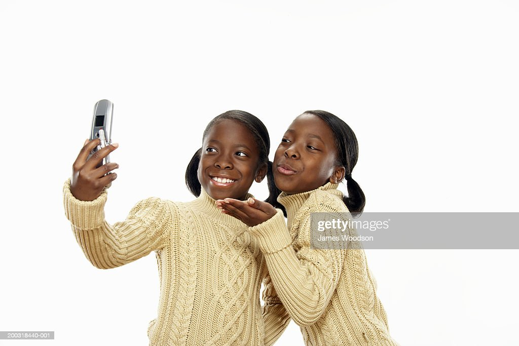 Happy couple blowing kiss and taking selfies Stock Photo, Royalty ...