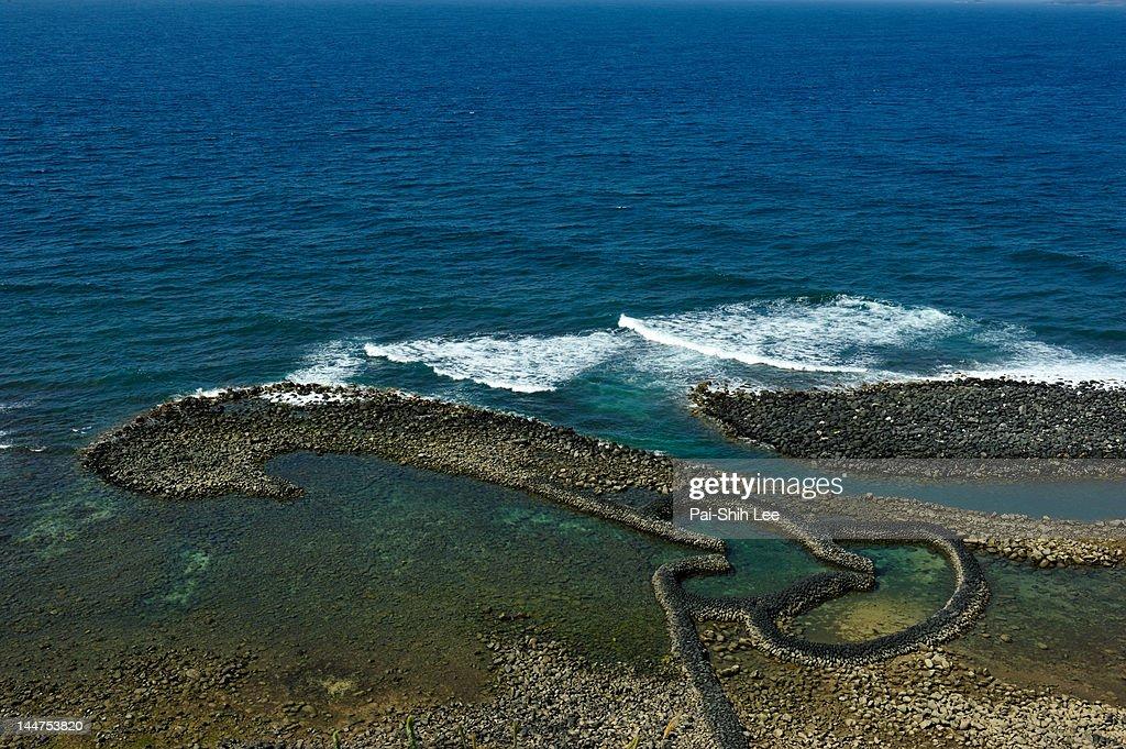Twin hearts stone tidal weir