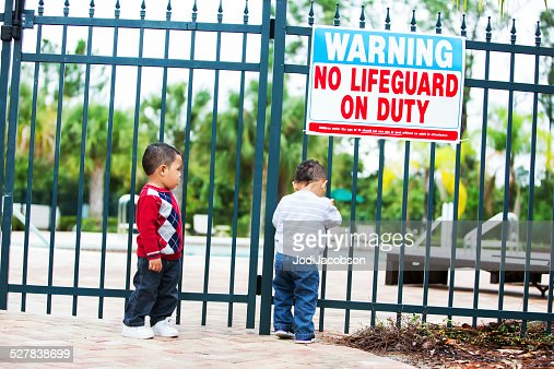 Twin Little Boys Try To Enter An Unlocked Swimming Pool Stock Photo Getty Images