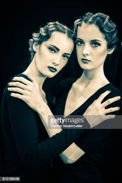 Twin models Giulia and Claudia Bonetti pose during the MercedesBenz Fashion Week Berlin Spring/Summer 2018 at Kaufhaus Jandorf on July 7 2017 in...