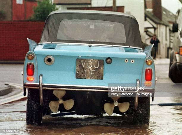 Twin propellers and aided by a high exhaust pipe gives the German built Amphicar owned by Ivor Newby from Bromsgrove a top speed of 5 knots in the...