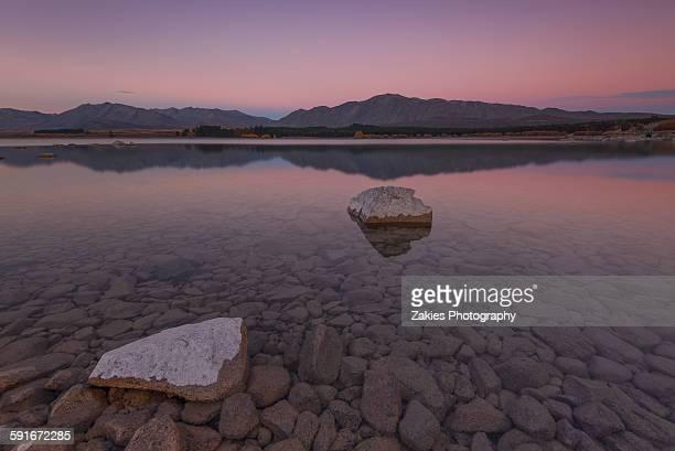 Twin rock in the water of lake Tekapo