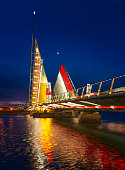 The Twin Sails Lifting Bridge was illuminated gold in support of childhood cancer. The red, gold and white lights are reflected in the waters of Holes Bay in Poole Harbour