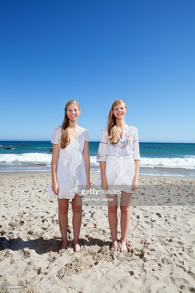 Twin Sisters at the beach : Stock Photo