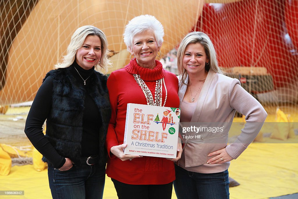 Twin sisters Chanda Bell (L) and Christa Pitts (R) celebrate with their mother, 'The Elf on the Shelf' co-author Carol Aebersold, at the inflation of the new 'Elf on the Shelf' balloon during the 86th Annual Macy's Thanksgiving Day Parade's 'Inflation Eve' on November 21, 2012 in New York City.