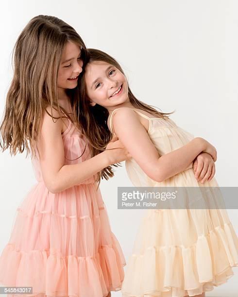 Twin sisters in a studio