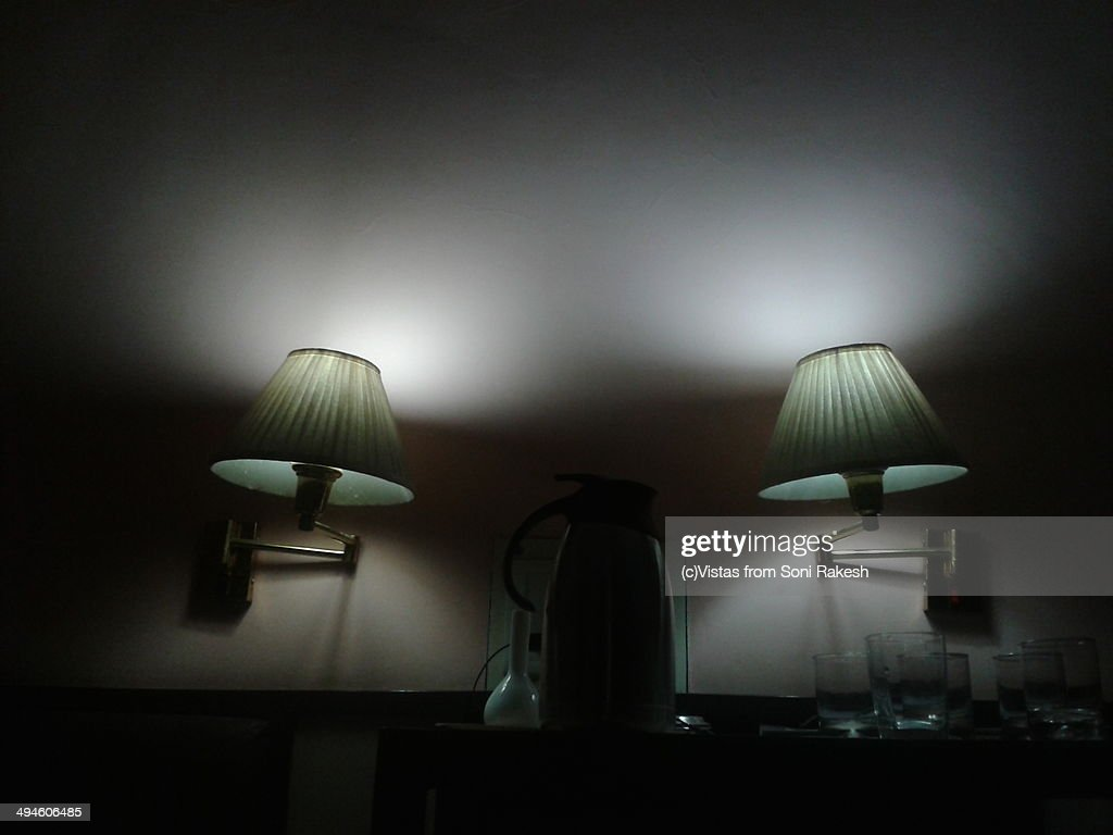 Twin Wall Mounted Reading Lamps In A Bedroom Stock Photo Getty Images