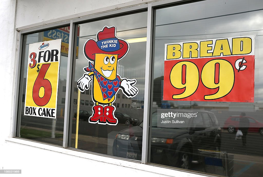 A Twinkie the Kid sign is posted on the window at a Wonder Hostess Bakery Outlet on November 16, 2012 in San Leandro, California. Hostess Brands, the maker of Twinkies, Ding Dongs and Wonder Bread, announced plans to liquidate its assets and lay off nearly 18,500 employees due to a workers strike brought on by an imposed contract that would cut workers' wages by 8 percent.