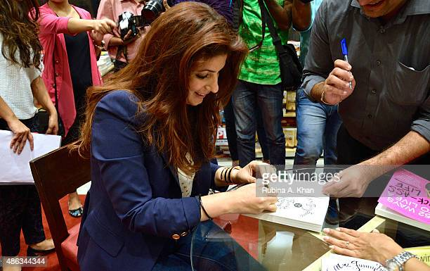 Twinkle Khanna signs copies of her debut book 'Mrs Funnybones' published by Penguin Random House at an In Conversation event at Crossword Book Store...