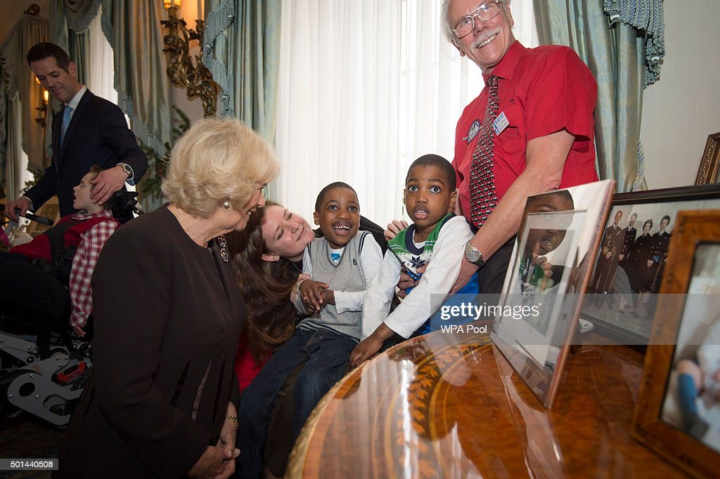 Twins Adam and Aten Ndaka 5 join Camilla, Duchess of Cornwall, patron of the Helen & Douglas House and The London Taxidrivers' Fund as she invites underprivileged children from both charities to decorate the Christmas tree and join the Duchess for Christmas lunch at Clarence House on December 15, 2015 in London, England.