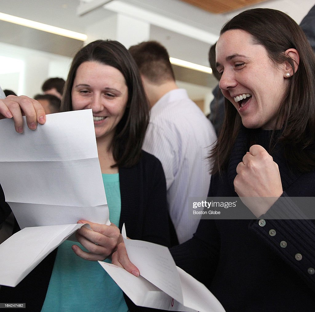 Twins Julia, left, and Lydia Parzych reacted during match day at UMass Medical School in Worcester, Friday, March 15, 2013. Lydia will work at UMass Medical Center while Julia will be at St. Vincent Hospital, both in Worcester.