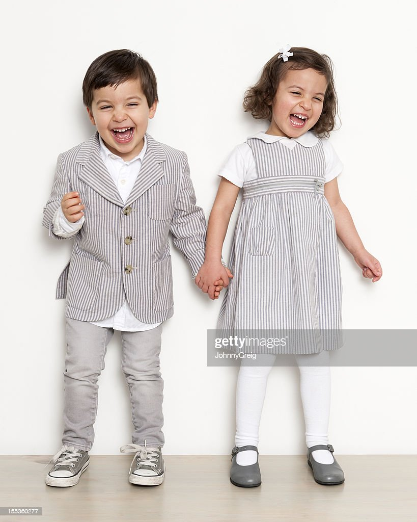 Twins Laughing : Stock Photo