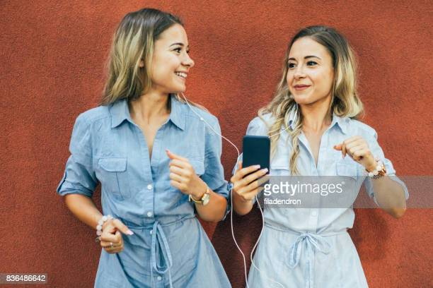Twins listening to music
