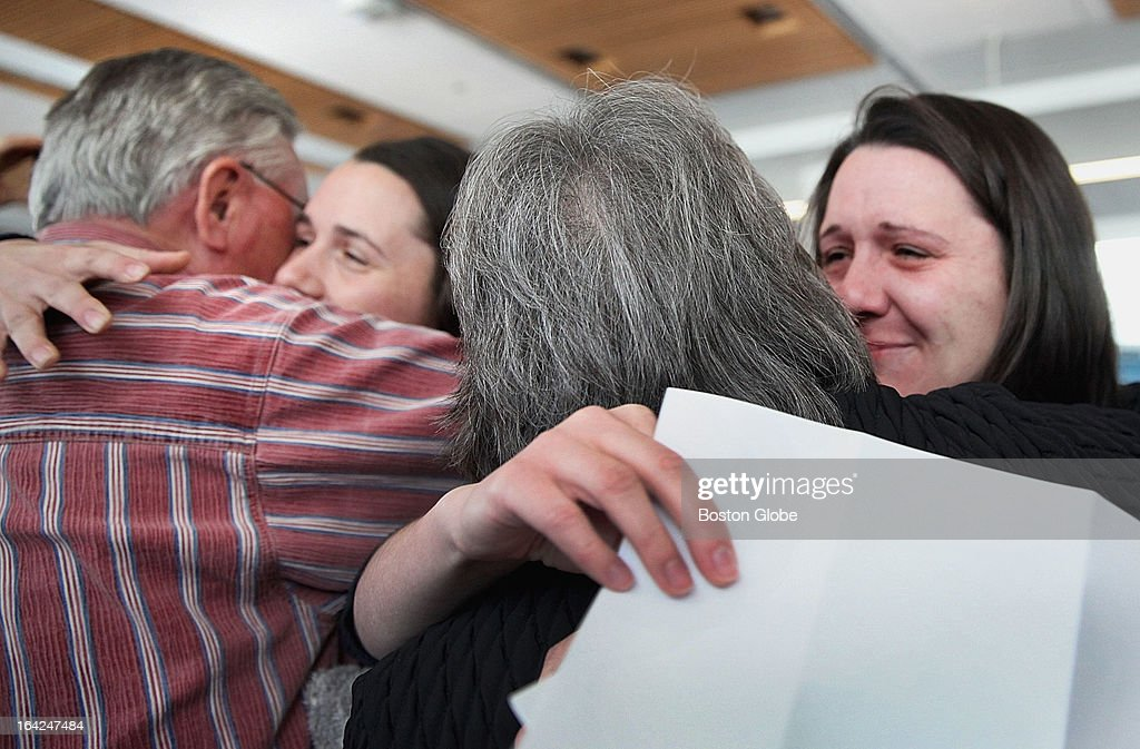 Twins Lydia, left, and Julia Parzych celebrated with their parents during match day at UMass Medical School in Worcester, Friday, March 15, 2013. Julia will be at St. Vincent Hospital while Lydia will be at UMass Medical Center, both in Worcester.