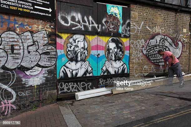 Twins of Brick Lane Street art by Zabou in the Brick Lane area of Shoreditch East London United Kingdom Street art in the East End of London is an...