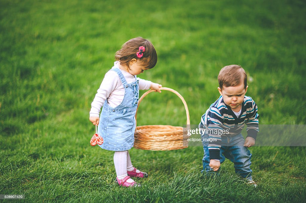 twins playing on meadow : Stock Photo