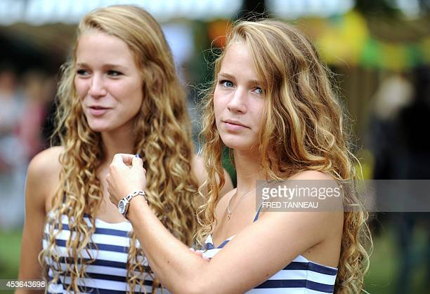 CAPTION Twins pose in the Fete des Jumeaux a gathering of twins triplets and quadruplets in Pleucadeuc France on August 15 2014 AFP PHOTO/ FRED...