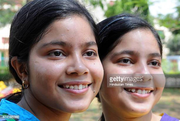Twins sister Aporupa and Anorupa Chattopadhyay students celebrates their performances after declaration of class 10th and 12th result of ICSE board...