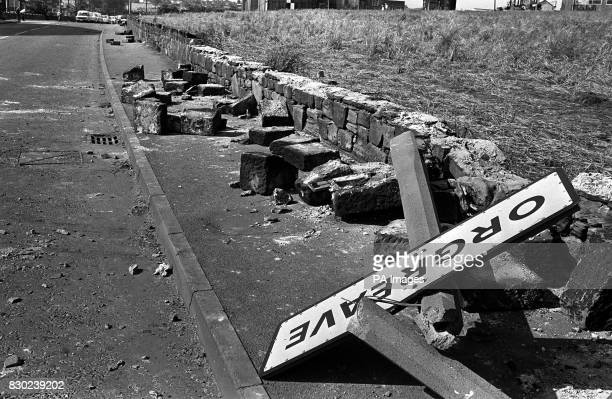 A twisted sign felled concrete posts and a broken wall tell the story of violence outside a coking plant in Orgreave South Yorkshire The plant was...