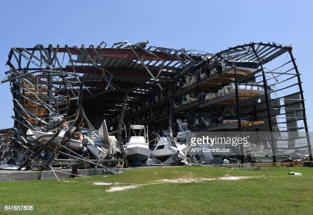 Twisted steel girders in the Cove Harbor Marina boat storage facility show the wind's strength after Hurricane Harvey caused widespread destruction...