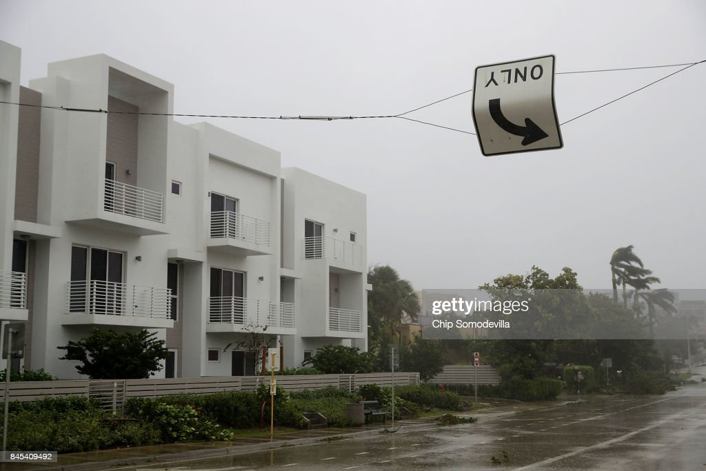 A twisted street sign turns in the wind along East Atlantic Boulevard as Hurricane Irma hits the southern part of the state September 10, 2017 in Pompano Beach, Florida. The Category 4 hurricane made landfall in the United States in the Florida Keys at 9:10 a.m. after raking across the north coast of Cuba.