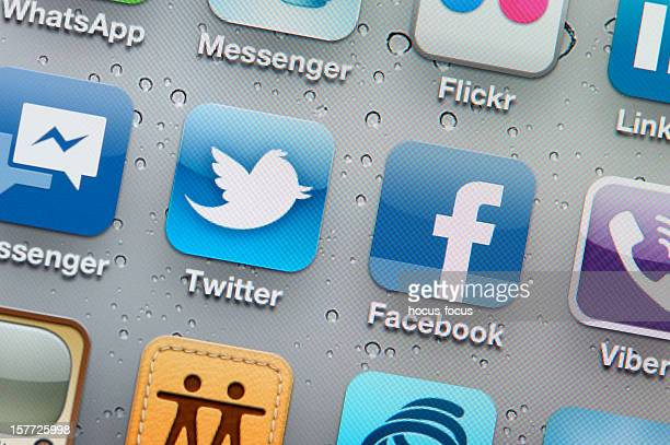 Twitter and Facebook icons on iPhone screen