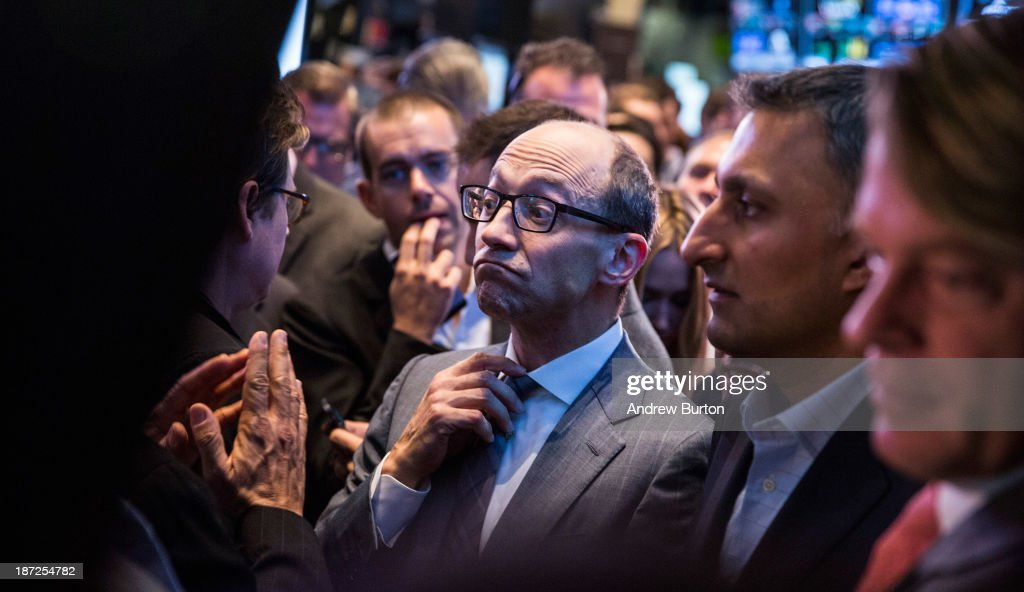 Twitter CEO Dick Costolo adjusts his tie while waiting to see what Twitter's opening market price will be on the floor of the New York Stock Exchange...