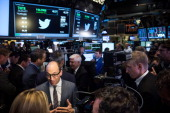 Twitter CEO Dick Costolo is interviewed by a broadcaster reporter after Twitter's IPO on the floor of the New York Stock Exchange on November 7 2013...