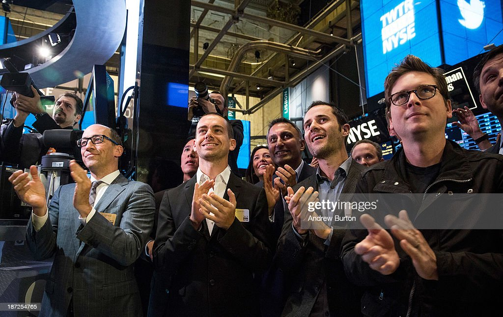 Twitter CEO Dick Costolo Twitter cofounder Jack Dorsey Twitter cofounder Evan Williams and Twitter cofounder Biz Stone applaud as Twitter rings the...