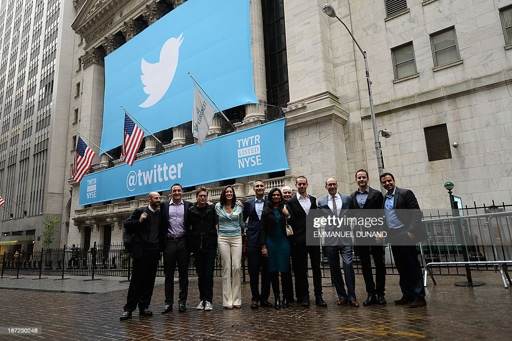 Twitter founders and management team pose in front of a banner with the logo of Twitter outside the New York Stock Exchange (NYSE) on November 7, 2013 in New York. Twitter hit Wall Street with a bang on Thursday, as an investor frenzy quickly sent shares surging after the public share offering for the fast-growing social network. In the first exchanges, Twitter vaulted 80.7 percent to $47, a day after the initial public offering (IPO) at $26 per share. While some analysts cautioned about the fast-changing nature of social media, the debut led to a stampede for Twitter shares.
