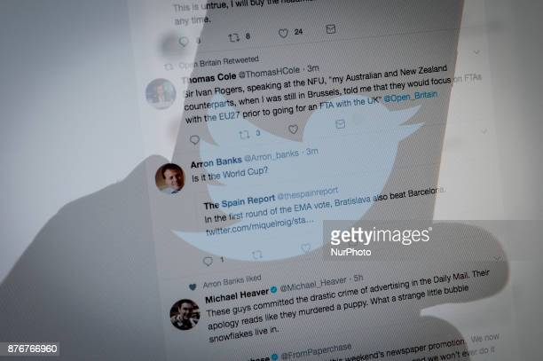 A Twitter logo is seen on a smartphone screen with a Twitter timeline in the background in this photo illustration on November 20 2017