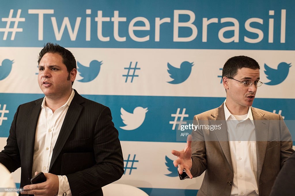 Twitter's Joel Lunenfeld (L), vice president of global brand strategy and Guy Yalif, head of global product marketing, speak with journalits after a press conference in Sao Paulo, Brazil on Februrary 20, 2013. Twitter began hunting for clients in Brazil with an eye on the upcoming Fifa World Cup Brazil 2014 and the Rio Olympic Games 2016. AFP PHOTO/Yasuyoshi CHIBA