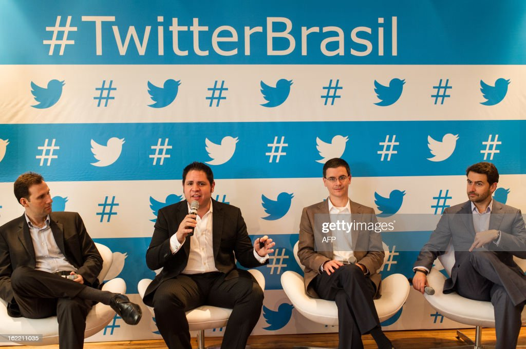 Twitter's vice president of global brand strategy Joel Lunenfeld (2nd-L) speaks during a press conference in Sao Paulo, Brazil on Februrary 20, 2013. Twitter began hunting for clients in Brazil with an eye on the upcoming Fifa World Cup Brazil 2014 and the Rio Olympic Games 2016. AFP PHOTO/Yasuyoshi CHIBA