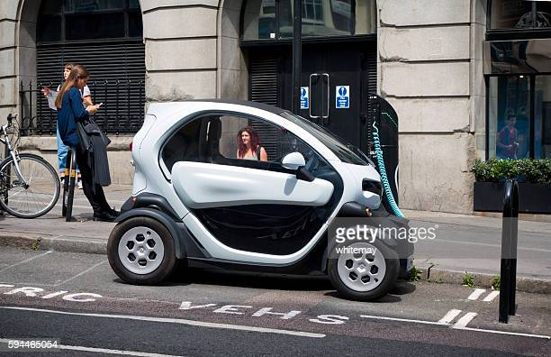 Twizy electric city car recharging in a London street