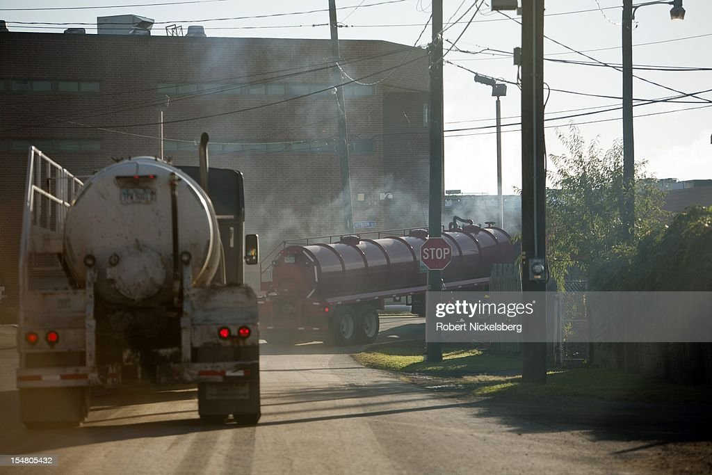 Two 18-wheel tractor trailers carry fresh water to natural gas wells being drilled by hydrofracking in the Marcellus Shale September 10, 2012 in Williamsport, Pennsylvania. Hydrofracking is a controversial drilling method which pumps millions of gallons of water, sand and chemicals into horizontally drilled wells to stimulate the release of the gas. The Marcellus Shale gas field stretches diagonally across West Virginia, Ohio, Pennsylvania and New York State. Drilling operations have provided Pennsylvania with billions of dollars of income through employment and tax revenue. The environmental impact is a politically sensitive issue in a resource dependent state.