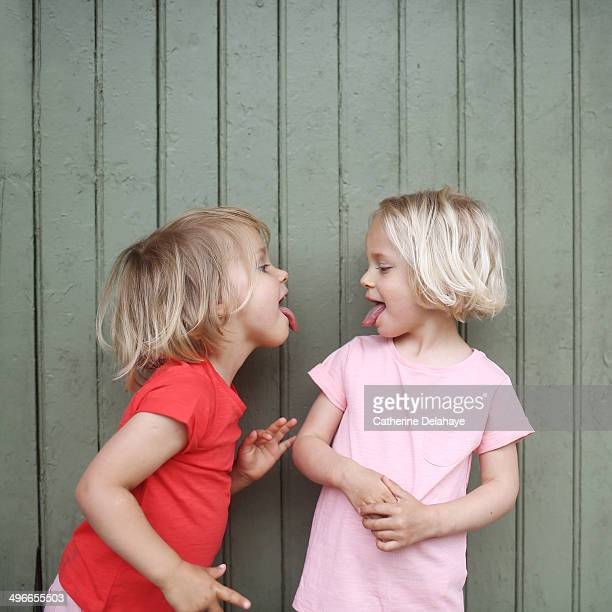 Two 3 years old twins girls playing together