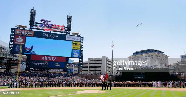 Two A10 Thunderbolt II 'Warthog' military aircraft jets fly over Comerica Park during Independence Day pregame ceremonies before the baseball game...