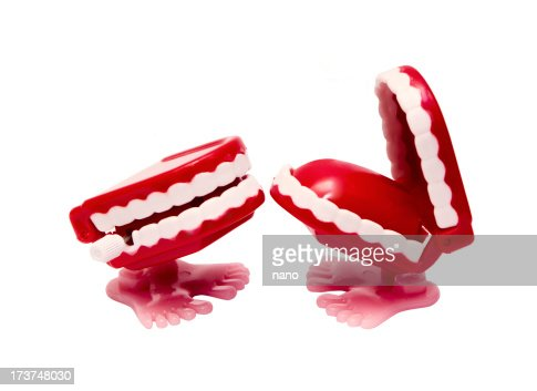Two abstract red mouths with feet causing the other to laugh