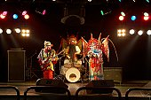 Two actors and an actress dressed as traditional Beijing Opera characters play rock and roll together on stage.